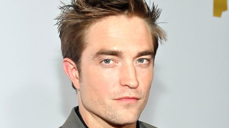 Robert Pattinson looking at the camera