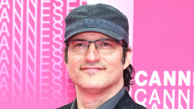 Robert Rodriguez wearing hat and glasses