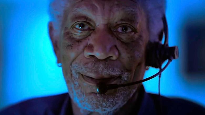 Morgan Freeman talks into a headset