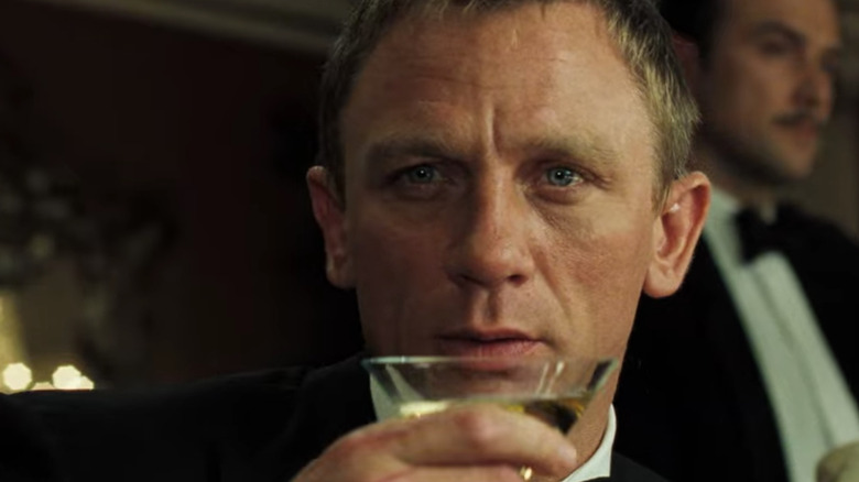 Daniel Craig sips drink