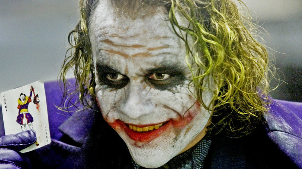 Joker with playing card