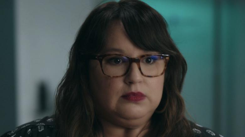 Jana Schmieding wears glasses and red lips