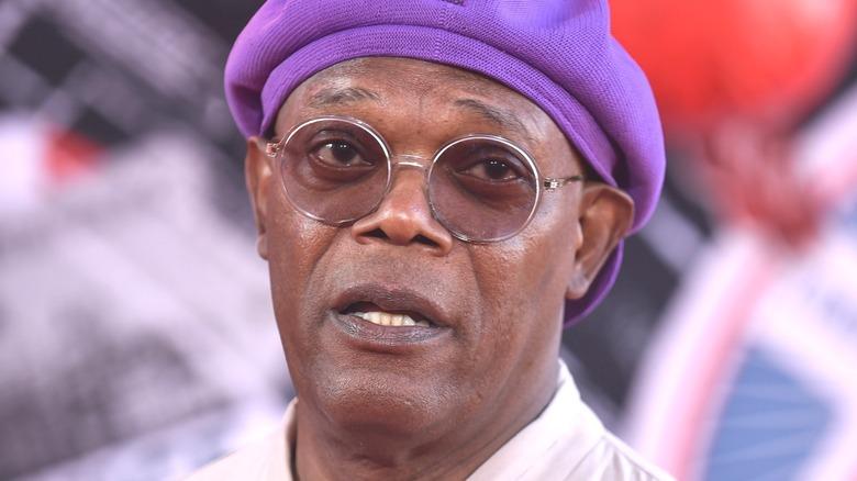 Samuel Jackson wearing purple hat