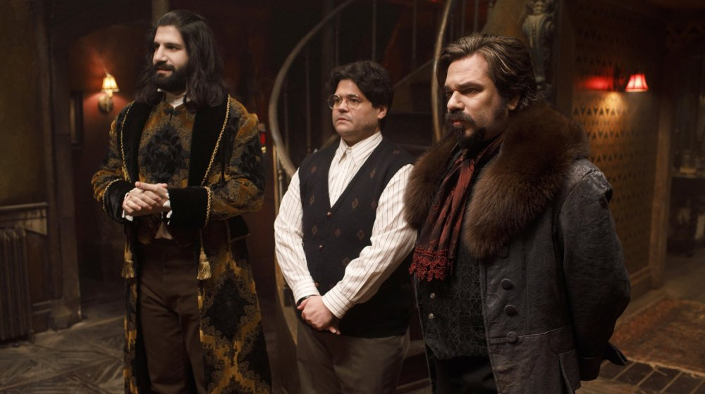 Nandor (Kayvan Novak), Guillermo (Harvey Guillen) and Laszlo (Matt Berry) receive visitors in the FX series, What We Do in the Shadows