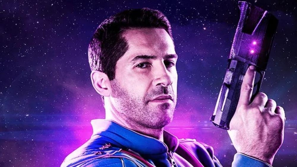 Max Cloud Scott Adkins poses with a space gun