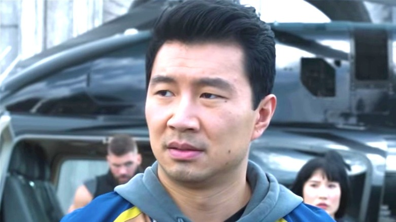 Shang-Chi in front of helicopter