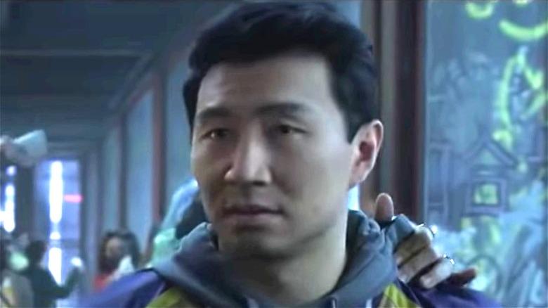 Simu Liu as Shang-Chi in gray hoodie