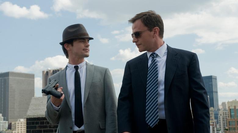Neal Caffrey Peter Burke staring