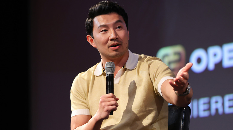 """Simu Liu speaking onstage at a Los Angeles Q&A for """"Shang-Chi and The Legend of the Ten Rings"""""""