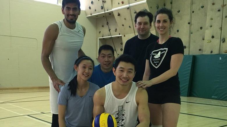 Simu Liu posing with fellow volleyball players