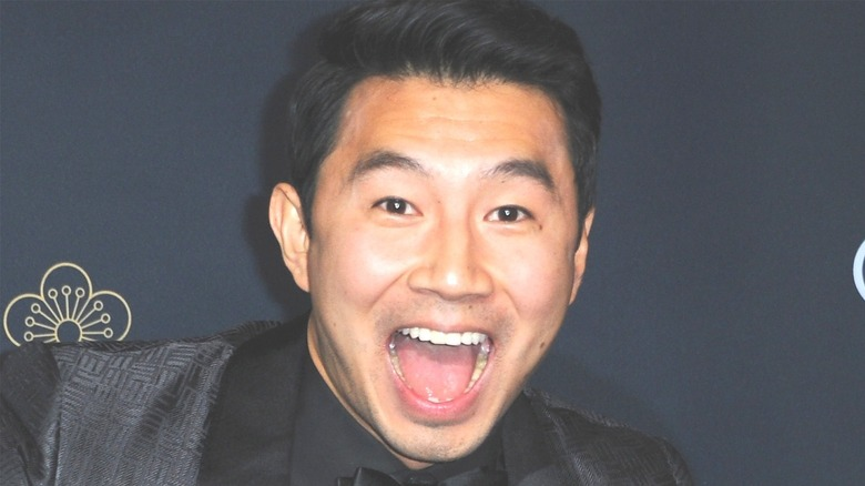 Simu Liu mouth open smile