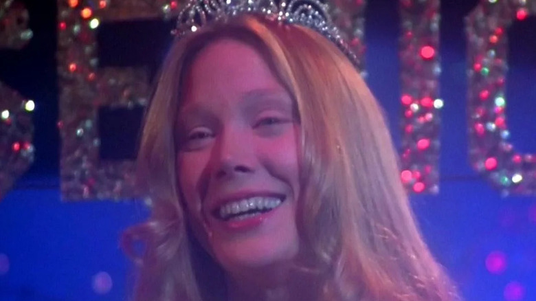 Carrie White smiling and wearing crown