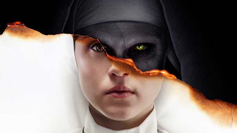 Charlotte Hope and Bonnie Aarons on The Nun poster