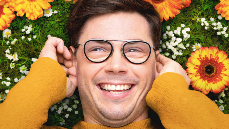 Ryan Hayes lying on grass