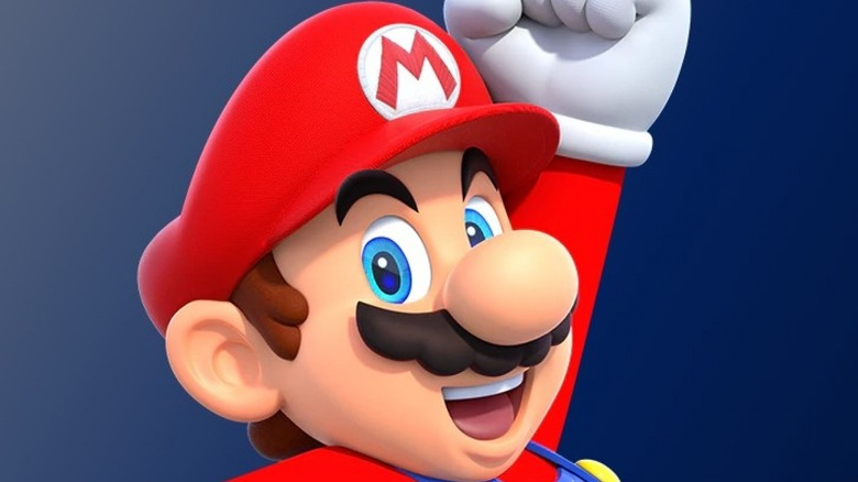 Mario celebrating and smiling