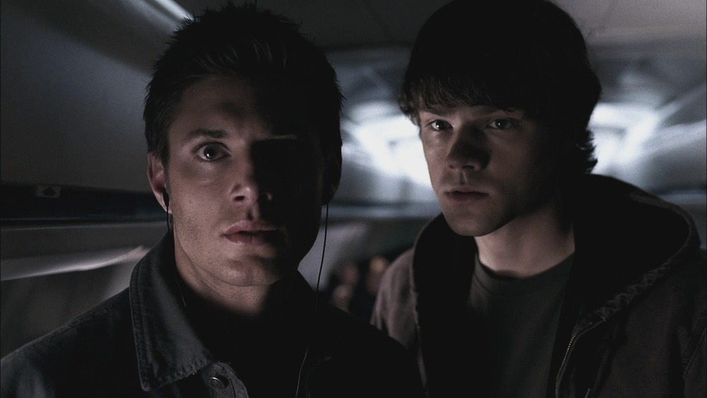 Dean and Sam on a plane