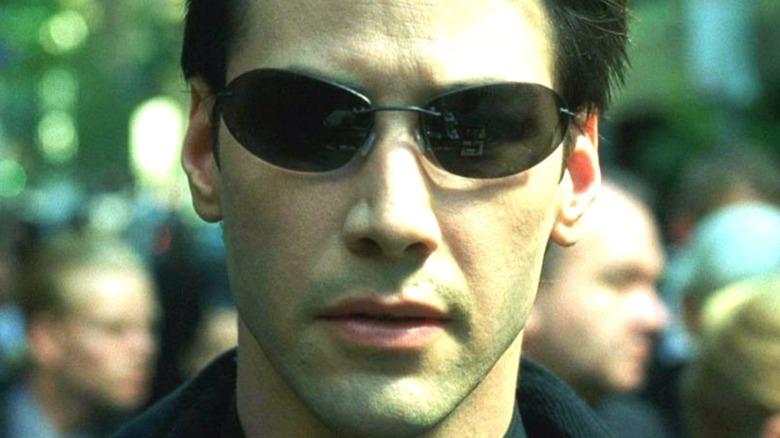 Neo wearing sunglasses