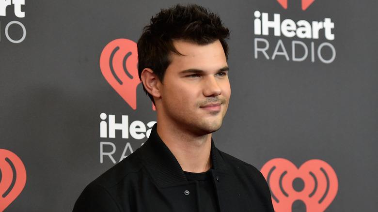 Taylor Lautner black jacket