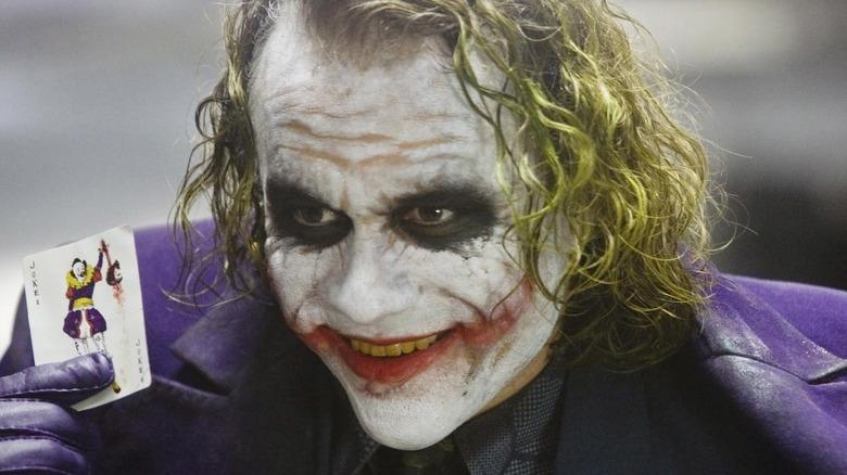 Heath Ledger Joker holding card