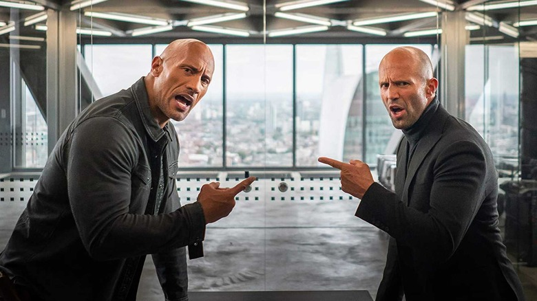 Hobbs & Shaw pointing at each other
