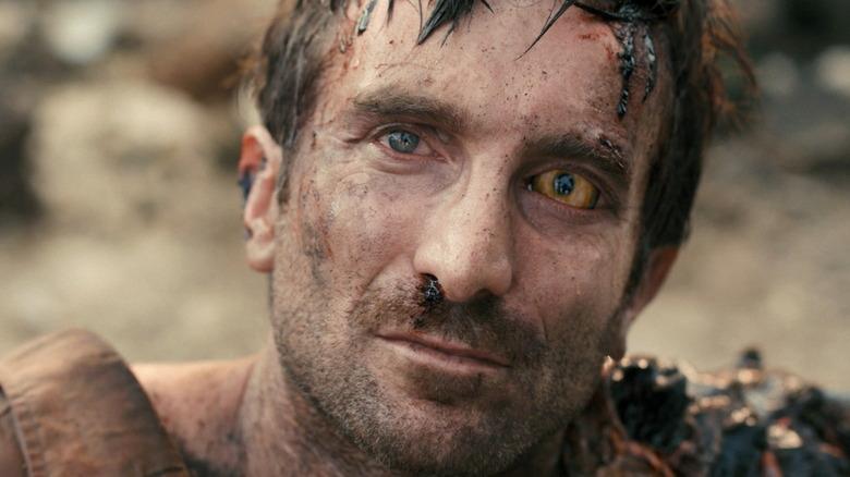 Sharlto Copley as Wikus van der Merwe in District 9