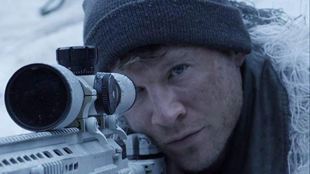 Chad Michael Collins aiming rifle