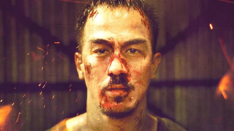 Joe Taslim with bloody face