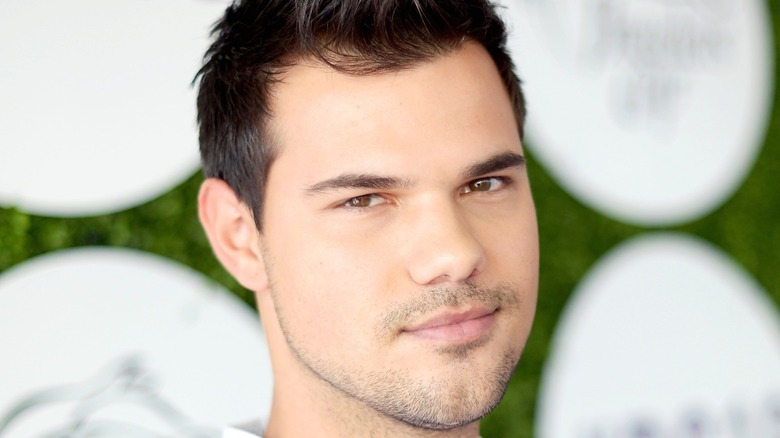 Taylor Lautner smiling at event