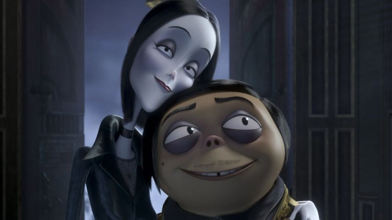 Morticia and Gomez embracing