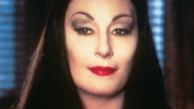 Anjelica Huston as Morticia Addams