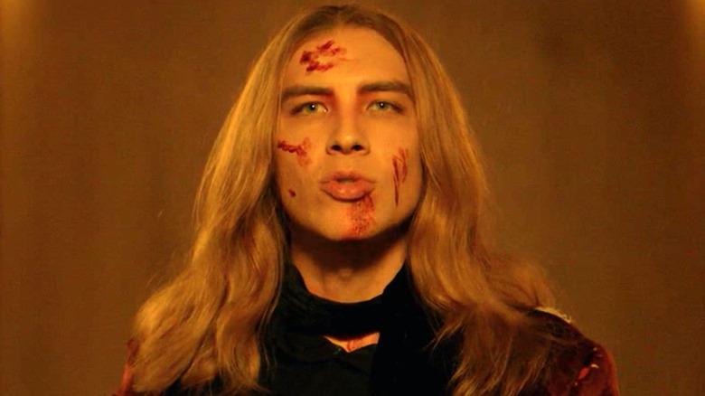Cody Fern as Michael Langdon, blood on face, in AHS Apocalypse