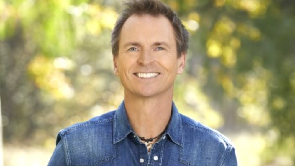 Phil Keoghan smiles on The Amazing Race