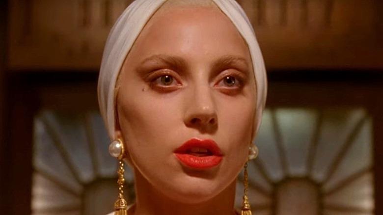 Lady Gaga bold lipstick and pearl earrings