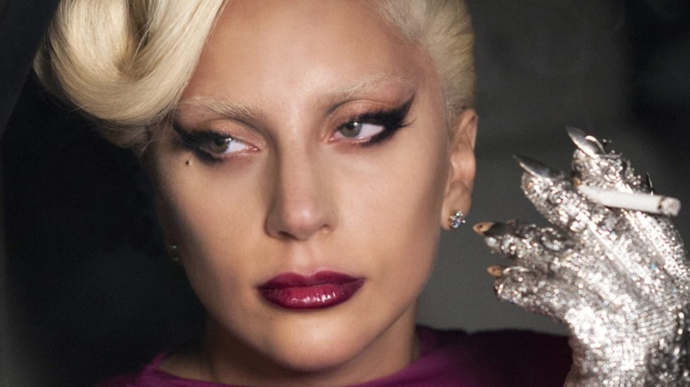 Lady Gaga holding cigarette in rhinestoned glove