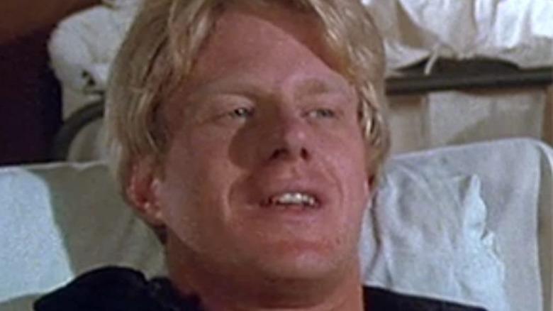 Ed Begley Jr. in a bed in MASH