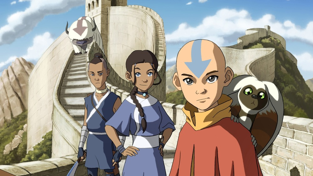 Aang, Katara, and Sokka stand on great wall
