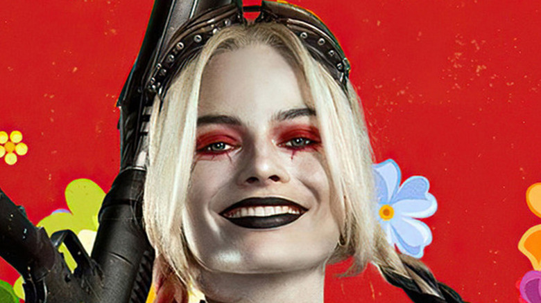 Harley Quinn smiling red background