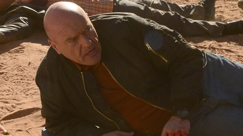Hank Schrader (Dean Norris) lays beside his deceased partner Gomez (Steven Michael Quesada) in a scene from Breaking Bad