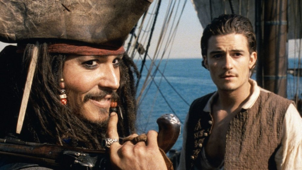 Johnny Depp as Jack Sparrow and Orlando Bloom as William Turner in Pirates of the Caribbean: Curse of the Black Pearl