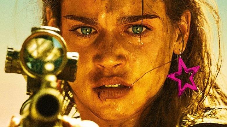 Jen holding sniper rifle