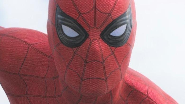 Spider-Man holding Cap's shield