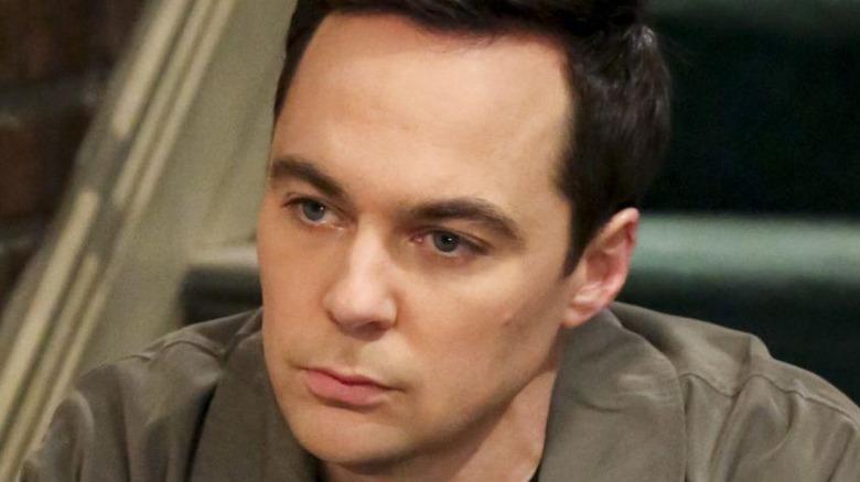 Sheldon Cooper sad and sitting on steps