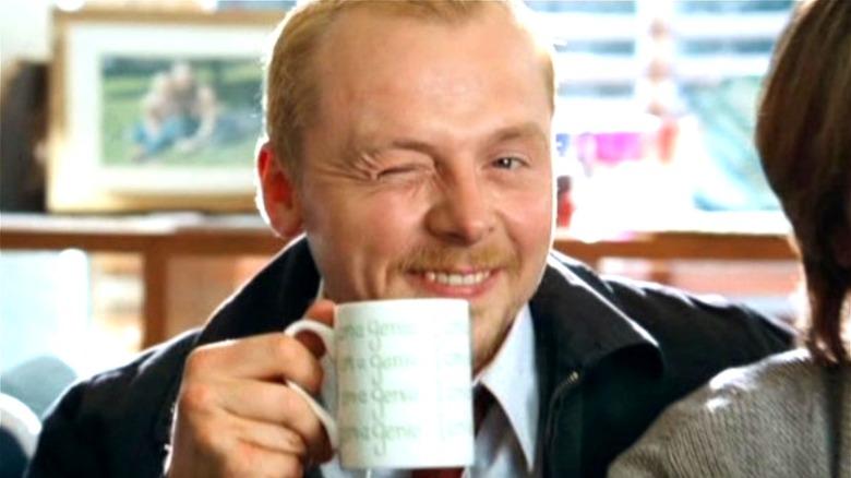 Simon Pegg Shaun smiling winking coffee