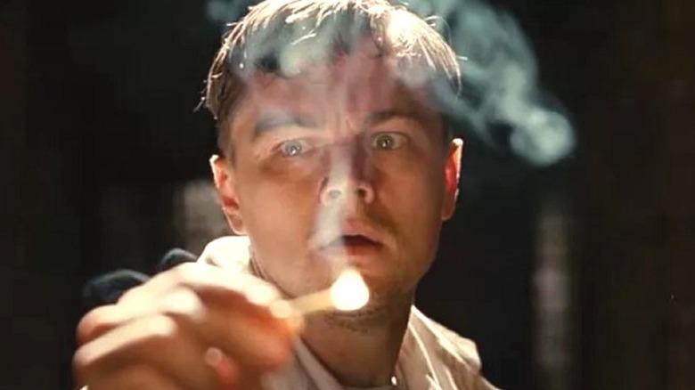 Leonardo DiCaprio holding a match