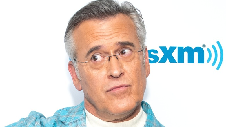Bruce Campbell in front of a white background