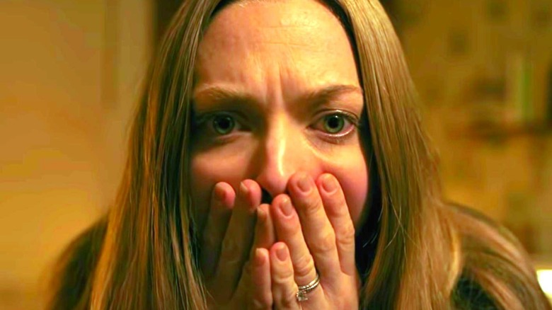 Catherine Clare scared hands on face