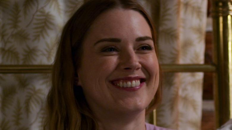 Mel smiling in her cabin