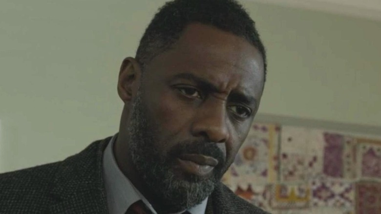Idris Elba as Luther looking down