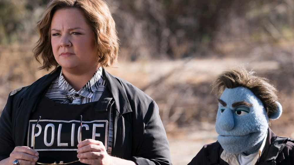 Melissa McCarthy as Connie Edwards and Bill Barretta as Phil Phillips in The Happytime Murders