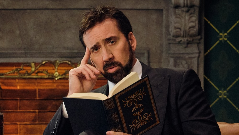 Nicolas Cage touching his temple
